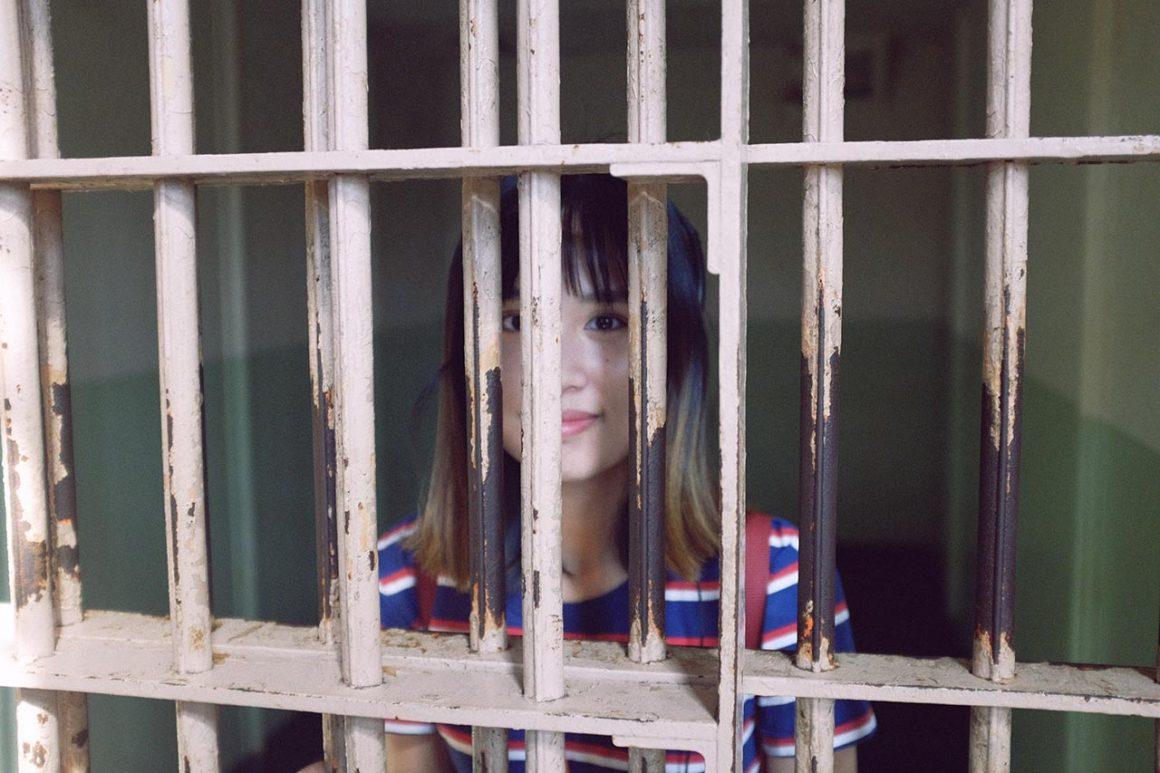 Girl inside Alcatraz Island prison cell