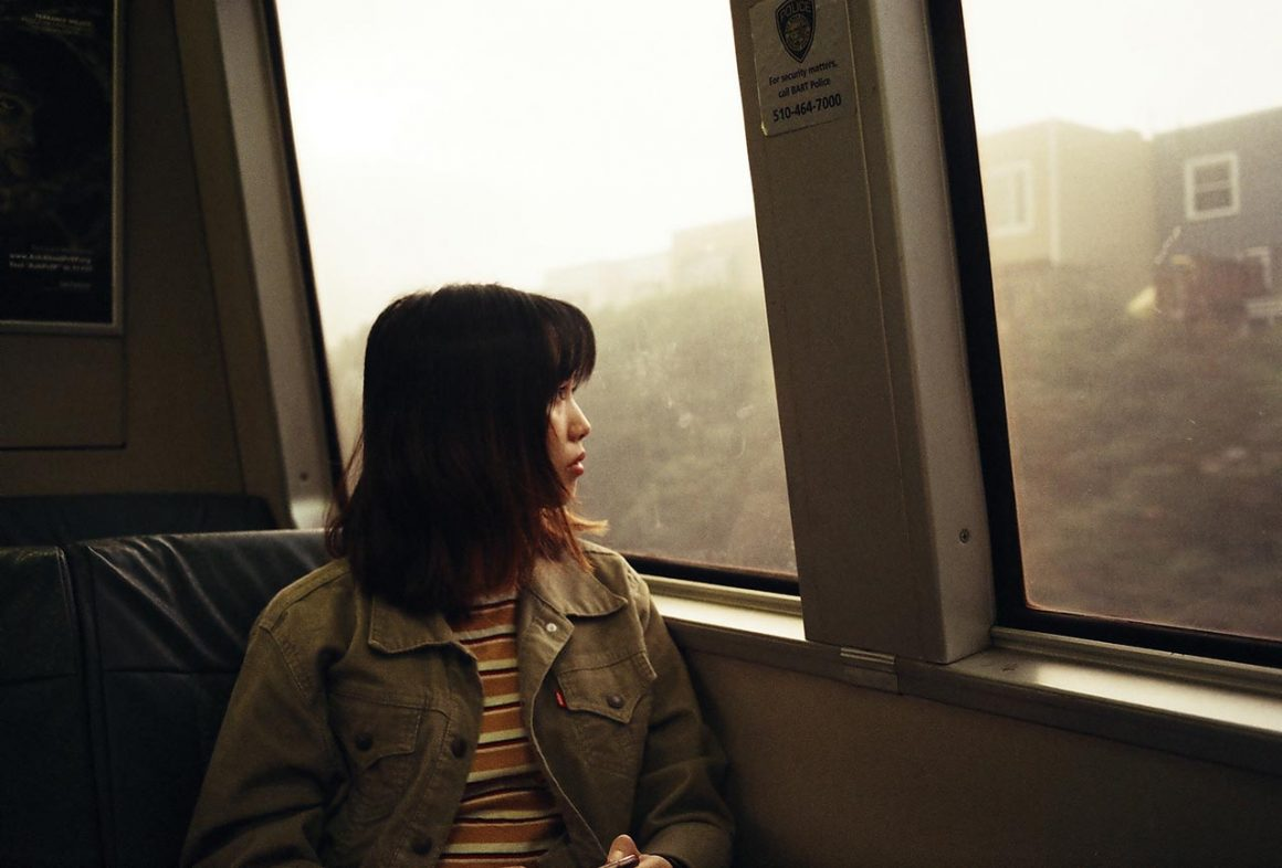 Girl on BART to San Francisco