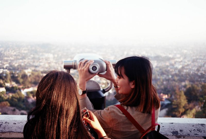 Girls overlooking Griffith Observatory in Los Angeles at sunset