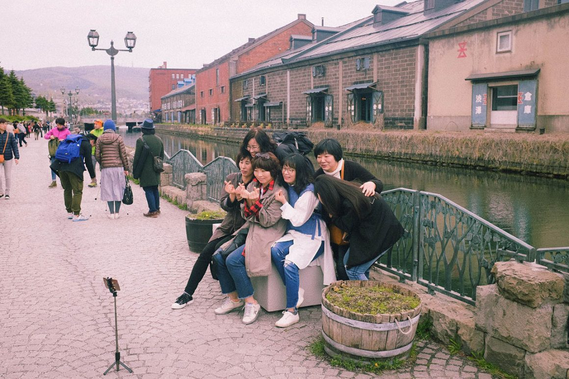 Tourists posing in front of the Otaru Canal